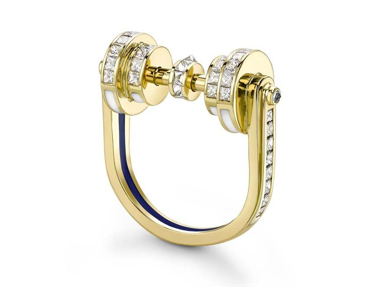 Emma Franklin diamond engagement ring in yellow gold with channel-set diamonds on all surfaces, blue sapphires, and enamel lines in blue and white.