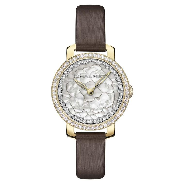 Chaumet Hortensia watch with a mother-of-pearl marquetry dial, presented in a 31mm yellow gold case with a brown satin strap.
