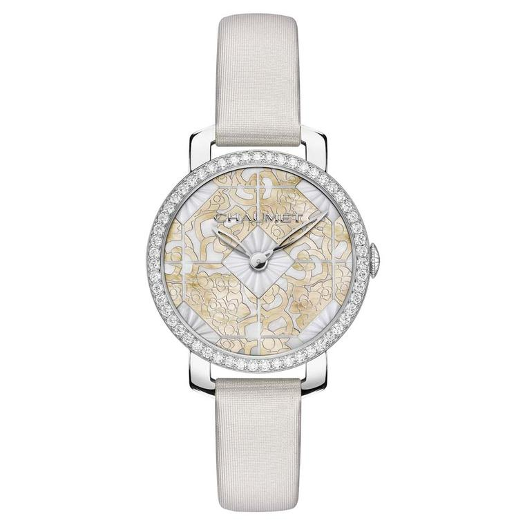 Chaumet Hortensia watch with a 31mm geometric dial, delicately engraved in gold mother-of-pearl and set into the white mother-of-pearl hexagonal shapes in the centre.