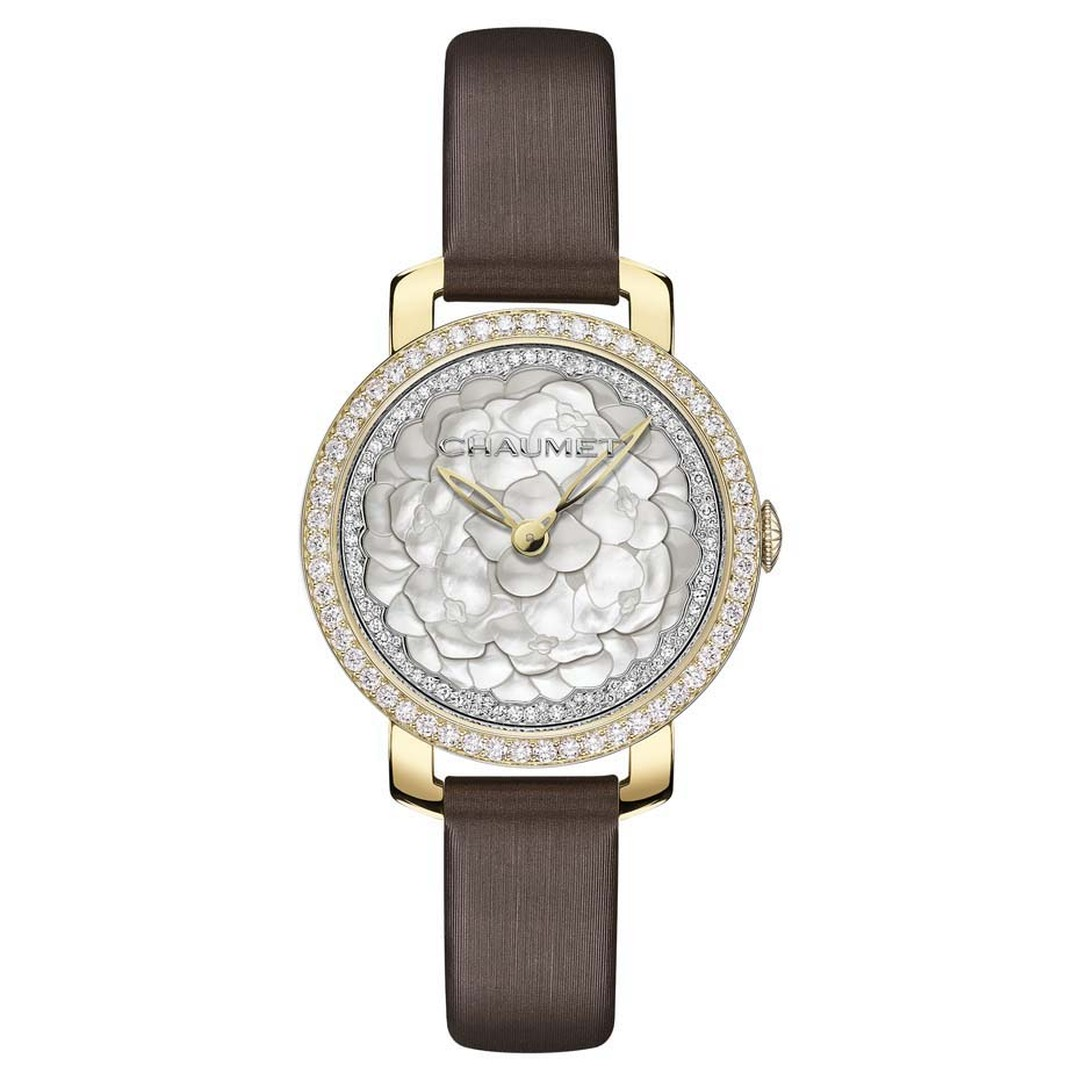 Chaumet Hortensia ladies' watch featuring a mother-of-pearl marquetry dial is presented in a 31mm yellow gold case and a brown satin strap.