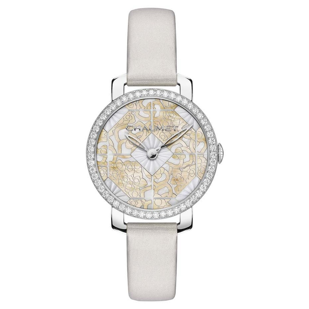 Chaumet Hortensia ladies' watch with a 31mm geometric dial has been delicately engraved in gold mother-of-pearl and set into the white mother-of-pearl hexagonal shapes in the centre.