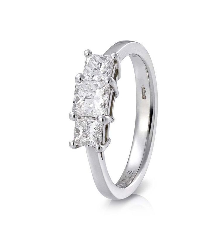 Boodles Trilogy three stone engagement ring in platinum with three radiant-cut diamonds.
