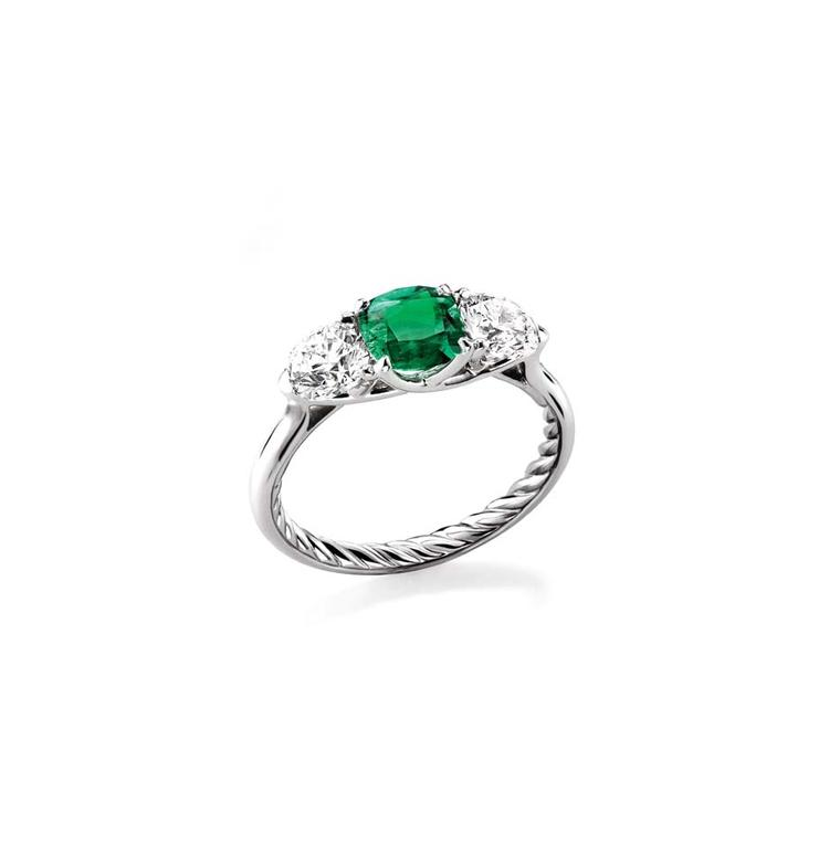 David Yurman Classic three stone engagement ring in platinum set with an emerald and two diamonds.