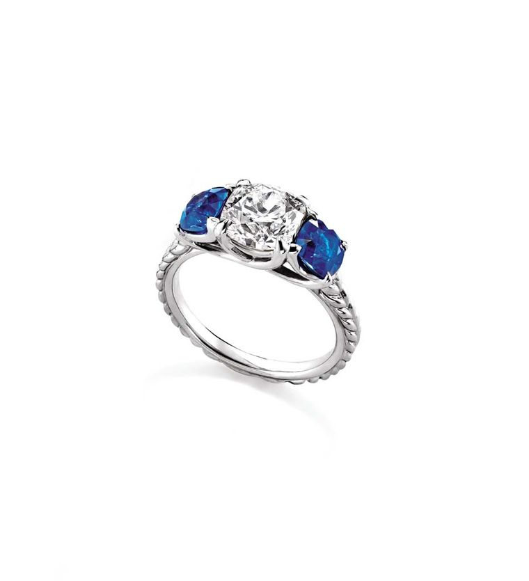 David Yurman Classic three stone engagement ring in platinum set with a diamond and two sapphires.