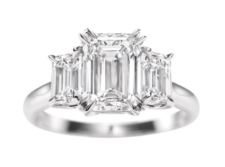 Harry Winston three stone emerald-cut engagement ring.