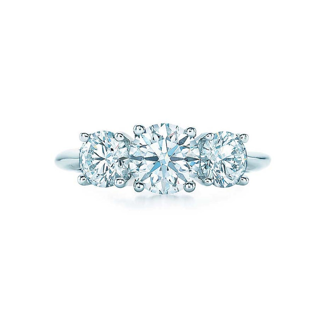 Tiffany & Co.'s three stone engagement ring is a classic design featuring three round brilliant diamonds perfectly matched for colour, quality and proportion.