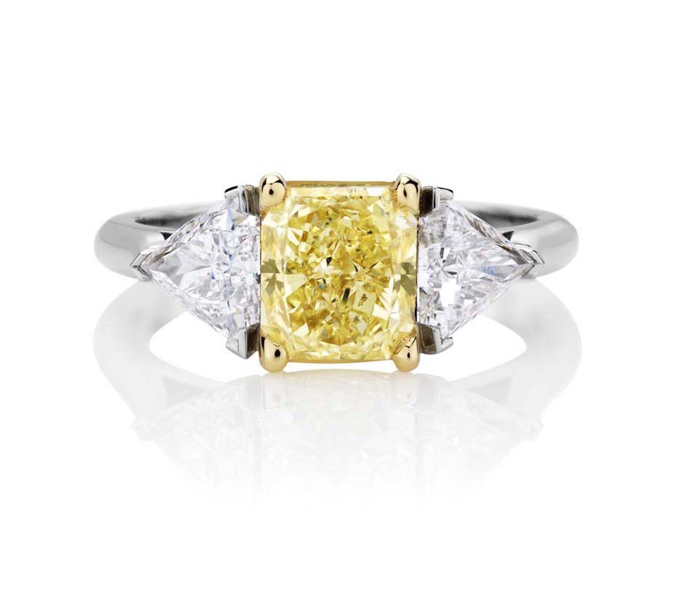 Part of De Beers jewellery's 1888 Master Diamonds collection, this one-of-a-kind three stone engagement ring is set with a 3.93ct Vivid yellow diamond flanked by trilliant-cut diamonds.