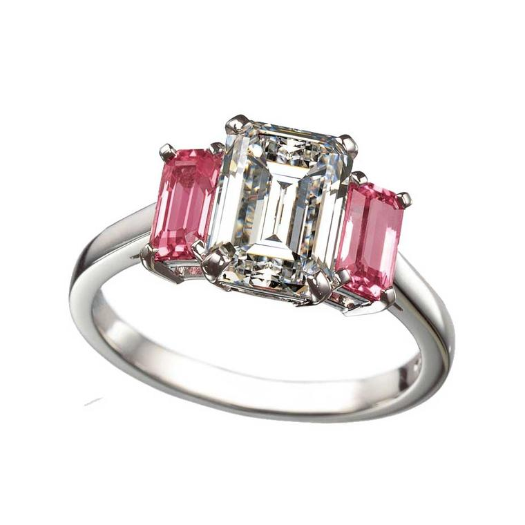 Ritz Fine Jewellery three stone engagement ring featuring an emerald-cut white diamond flanked by two emerald-cut pink diamonds.