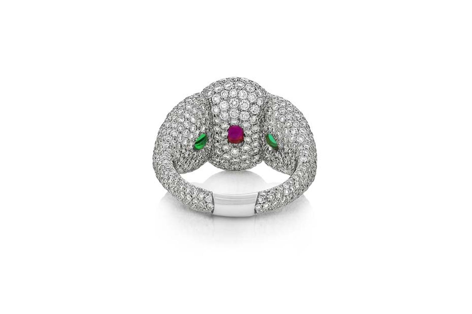The African ruby and emeralds peep through when viewed from behind in Niquesa's Rose of the Desert ring.