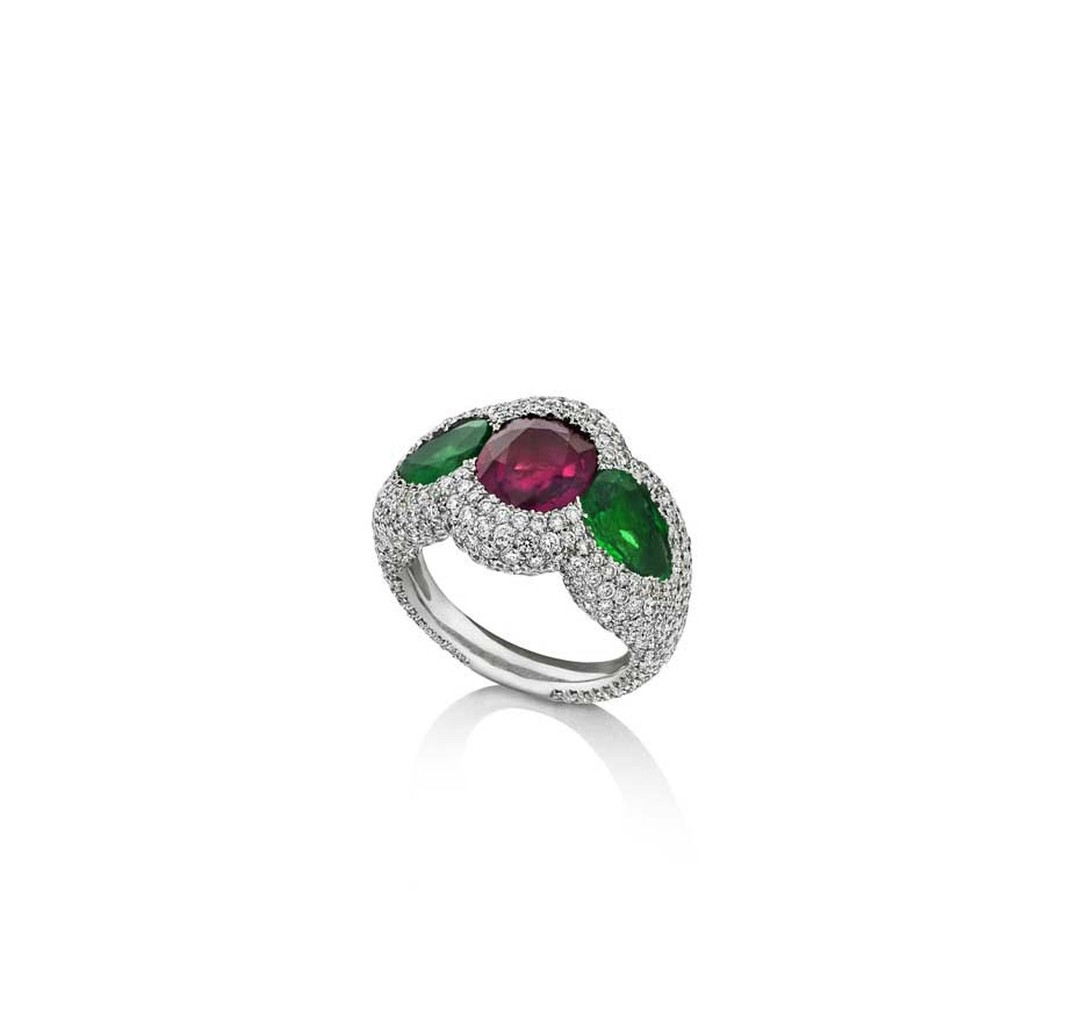 One-of-a-kind Niquesa Rose of the Desert ring set with a central Gemfields African ruby and Gemfields emeralds, encased in diamonds.