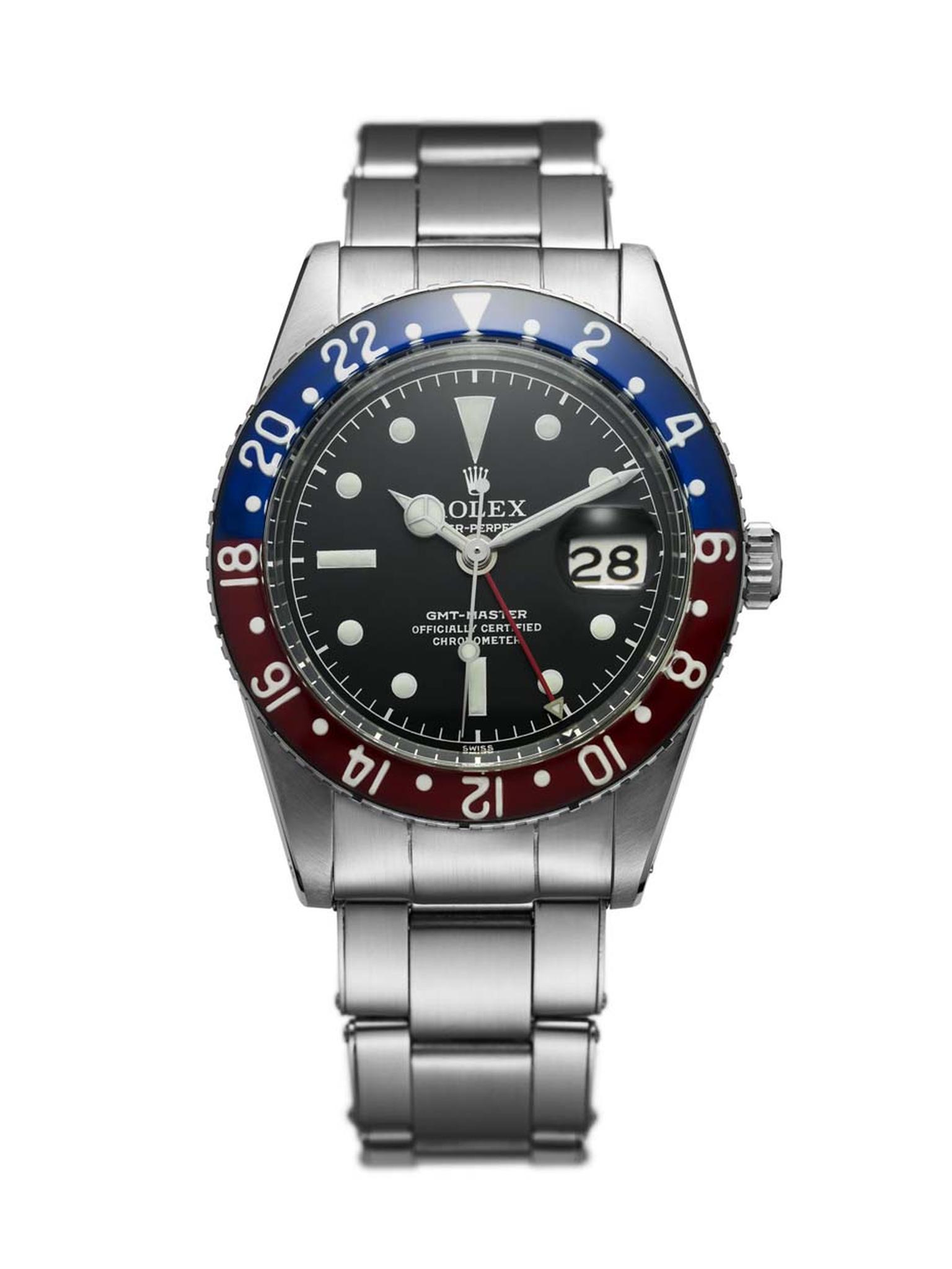 The Rolex GMT-Master watch from 1955 was specifically designed for Pan Am pilots who crossed multiple time zones. Also known as the Pepsi watch because of its red and blue rotating 24 hour bezel, the Rolex GMT-Master is one of Rolex' most sought-after wat