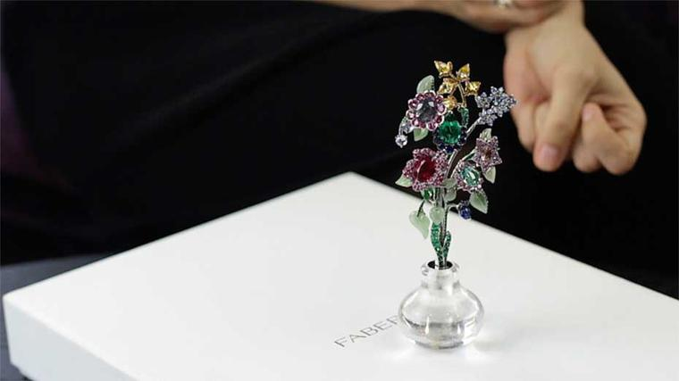 This beautiful Fabergé brooch takes the form of a delicate spray of flowers and, when not being worn, sits in a little rock crystal vase.