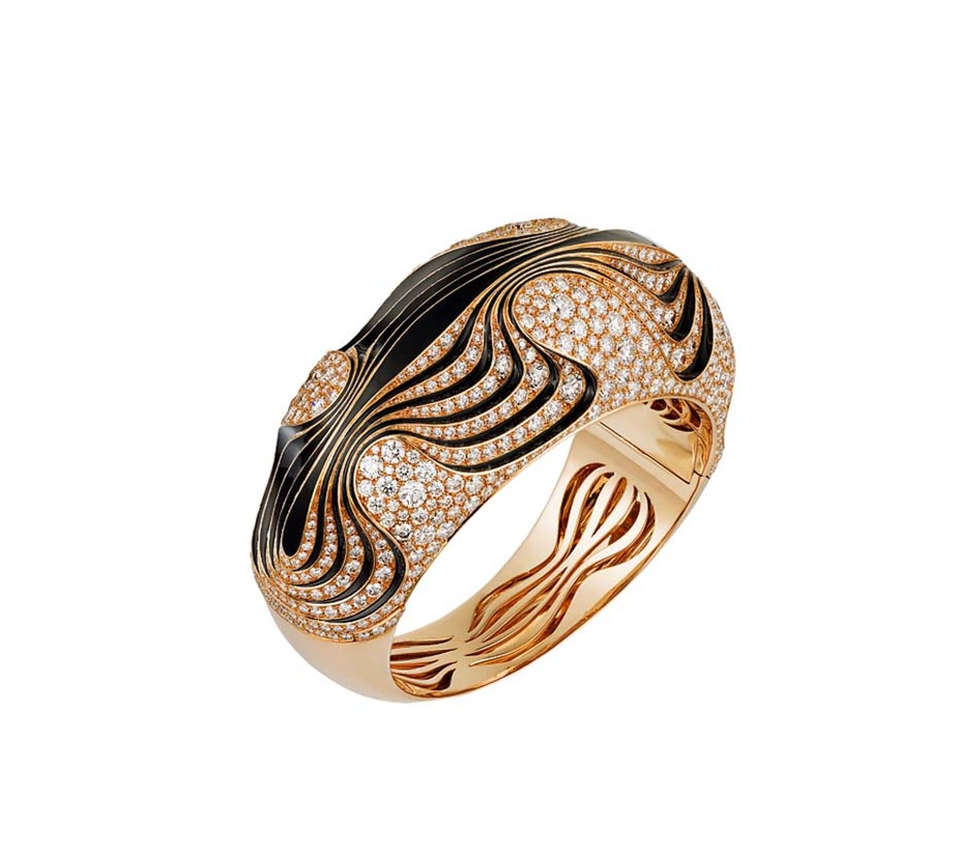 The contoured patterns of water on sand are exquisitely recreated by Cartier in this gold, lacquer and diamond bracelet from the latest collection of Paris Nouvelle Vogue jewellery, launched recently in Paris.
