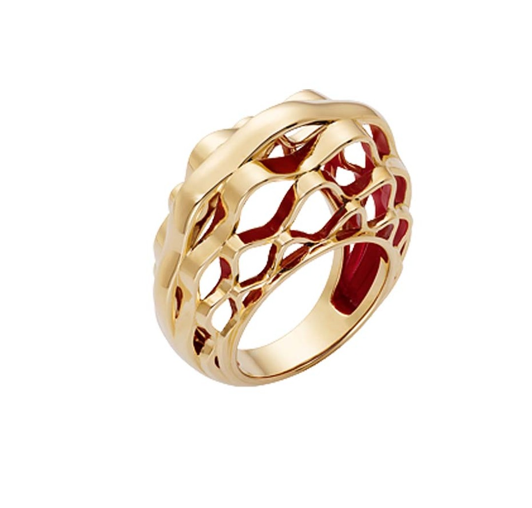 The metalwork of the glass dome of the Grand Palais is interpreted by Cartier in this dramatic ring that resembles golden basketwork - one of the new Paris Nouvelle Vague jewels.
