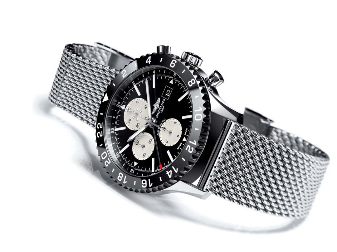 The Breitling Chronoliner watch is inspired by a model from 1950 and features a high-tech ceramic bezel with contrasting numbers, a 46mm steel case with a steel mesh bracelet, and a COSC-certified high frequency movement.