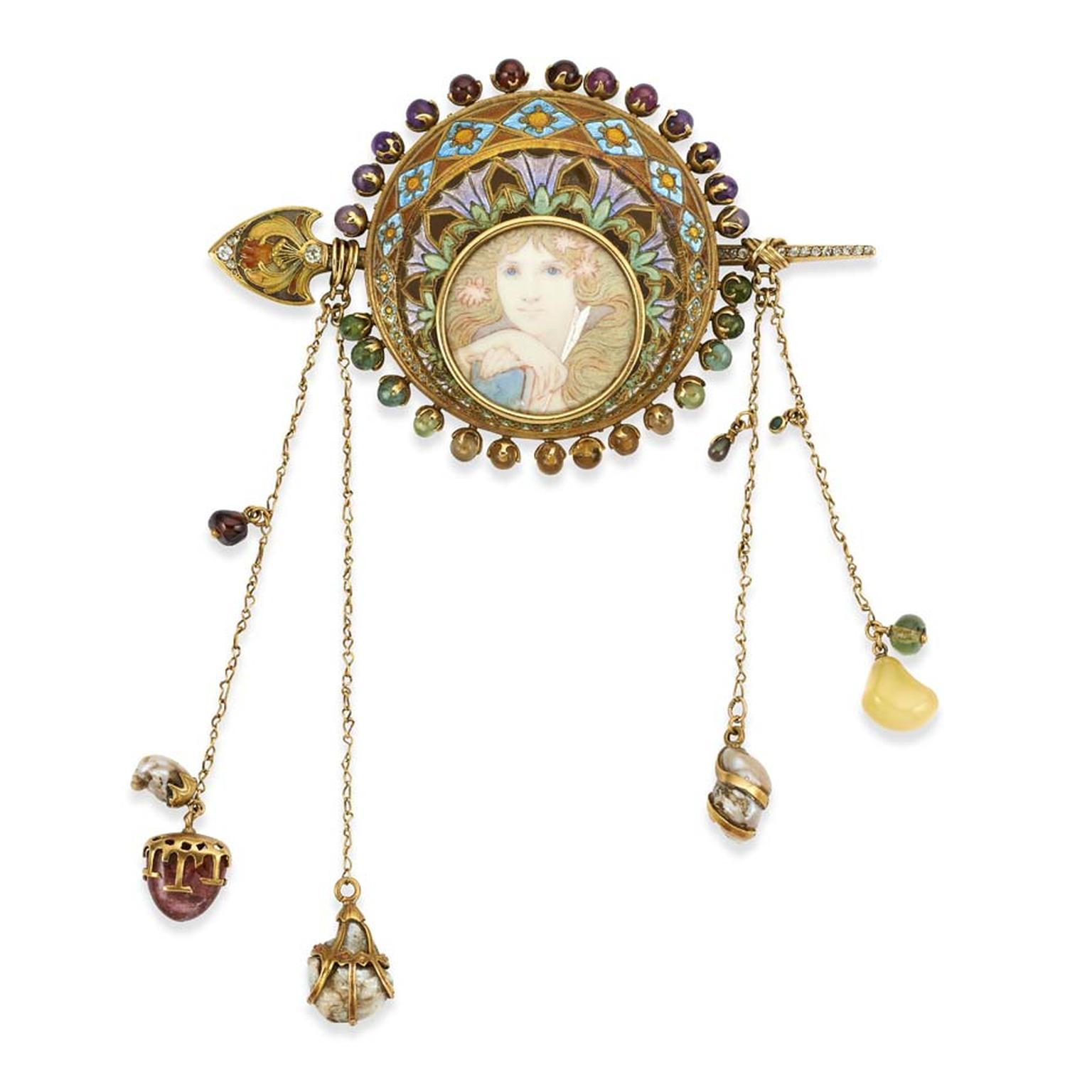 Gold corsage designed by the painter Alphonse Mucha and crafted by the French jeweller George Fouquet. Offered for sale at TEFAF by British antique dealers Wartski.