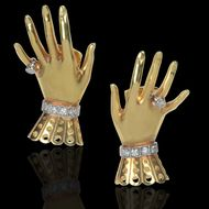 "A whimsical pair of yellow gold and diamond ""Hand & Glove"" earflaps by Paul Flato, circa 1950, which are being sold by Hancocks for £39,500 at TEFAF Maastricht."