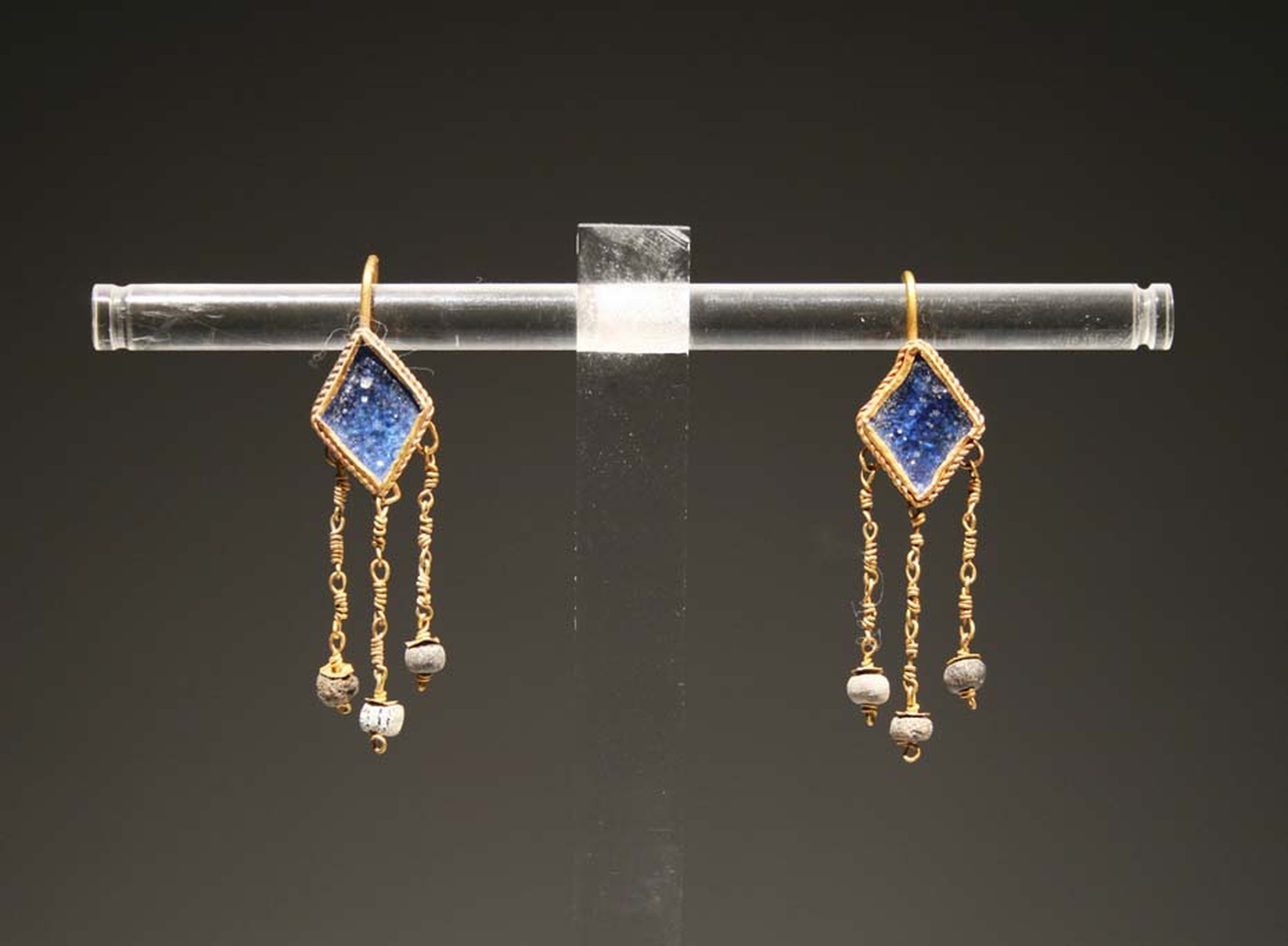 Antiquities dealer Jean-David Kahn, whose sculptures can sell for seven figures, is selling several lovely, affordable jewels at TEFAF, among them a pair of Roman blue glass, angle earrings made between the 1st and 3rd centuries AD at €3,500.