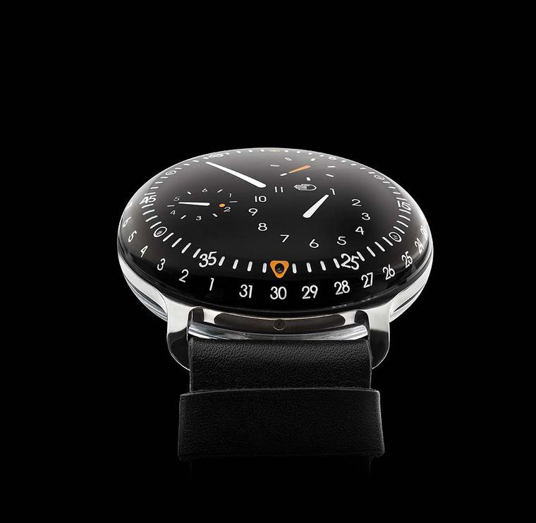 The Ressence Type 3 watch literally sees time floating under a bubble that curves up towards the viewer with its clear symbols marking the hours, minutes, seconds, days and date without the aid of hands or a crown.