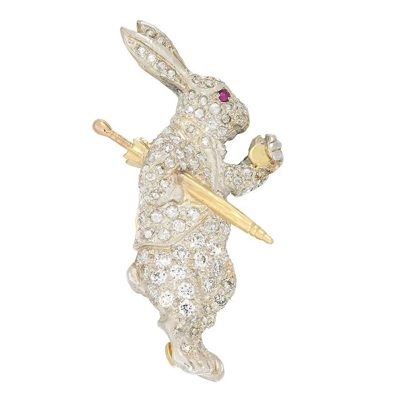 Bentley & Skinner White Rabbit antique jewellery brooch in yellow gold, set with a ruby and 1.10ct of diamonds.