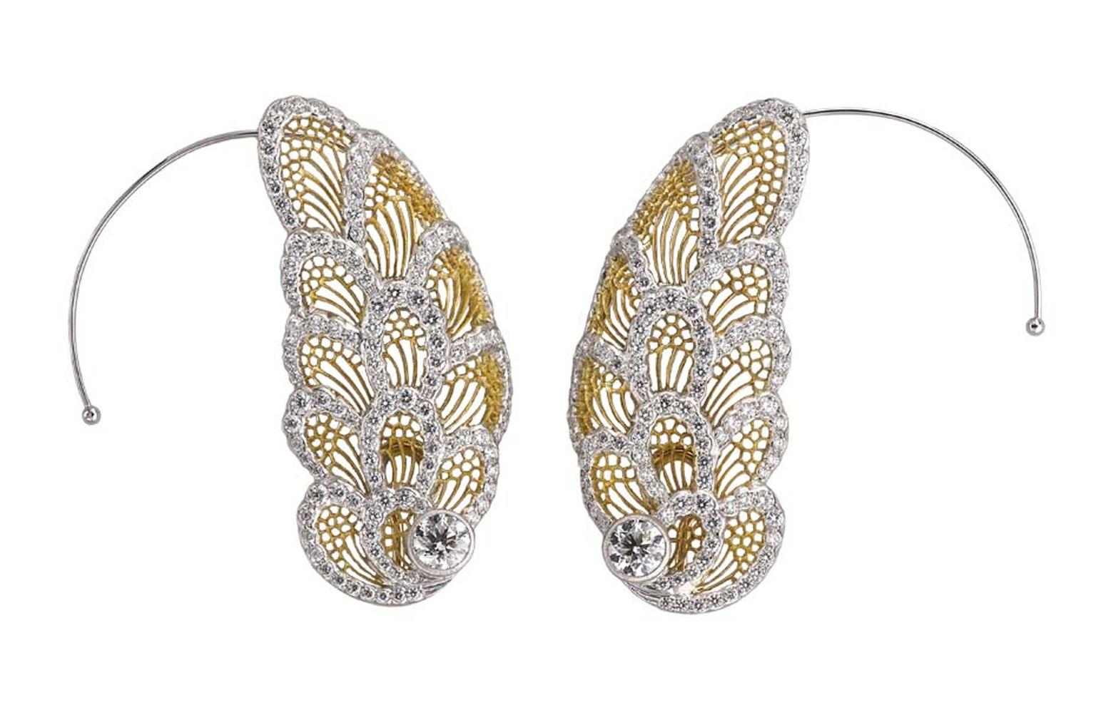 "Buccellati's high jewellery wing earrings, entirely handcrafted with the Tulle technique and reminiscent of Redon's ""Fall of Phaeton"" painting, fly along the earlobe. The feather-like elements of the ear cuffs are set with diamonds, and a subtle hook prev"