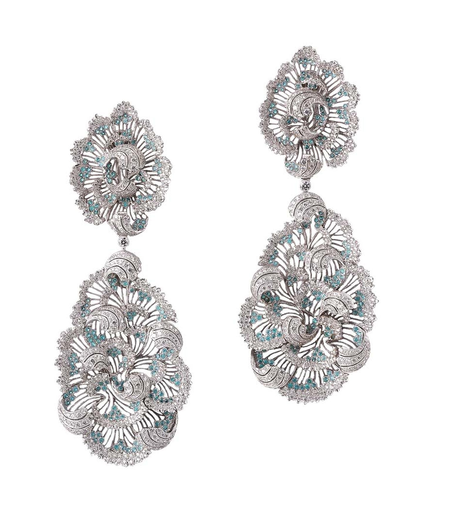The complex design of Buccellati's white gold pendant earrings stays true to its enchanting style, infusing elegant curls with 1,066 round brilliant-cut diamonds and 354 Paraíba tourmalines.