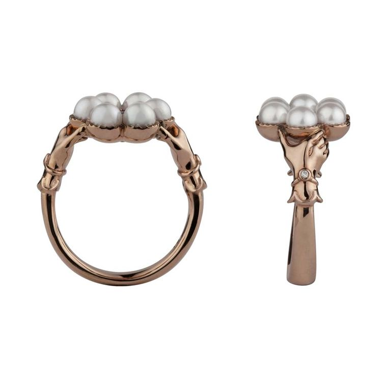 Stephen Einhorn Posey ring in rose gold, set with Akoya pearls and a ruby. Viewed side-on you can see the hands clasping the circle of pearls - a very traditional English design popular in the early 19th century.