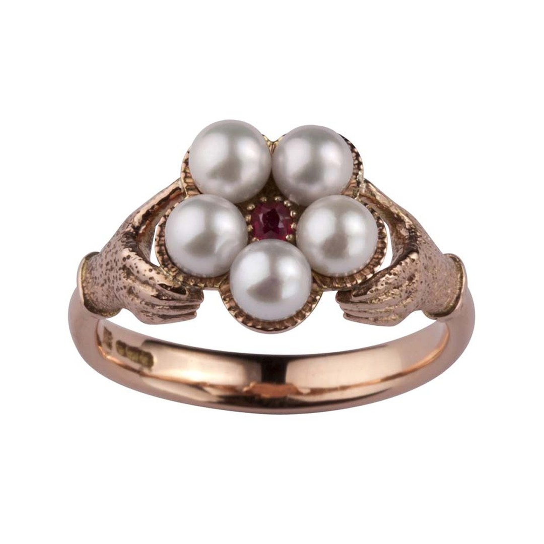The bespoke rose gold, Akoya pearl and ruby ring made by Stephen Einhorn for Cate Blanchett to wear in Disney's remake of Cinderella, released this weekend in the OK. Blanchett plays the wicked stepmother.
