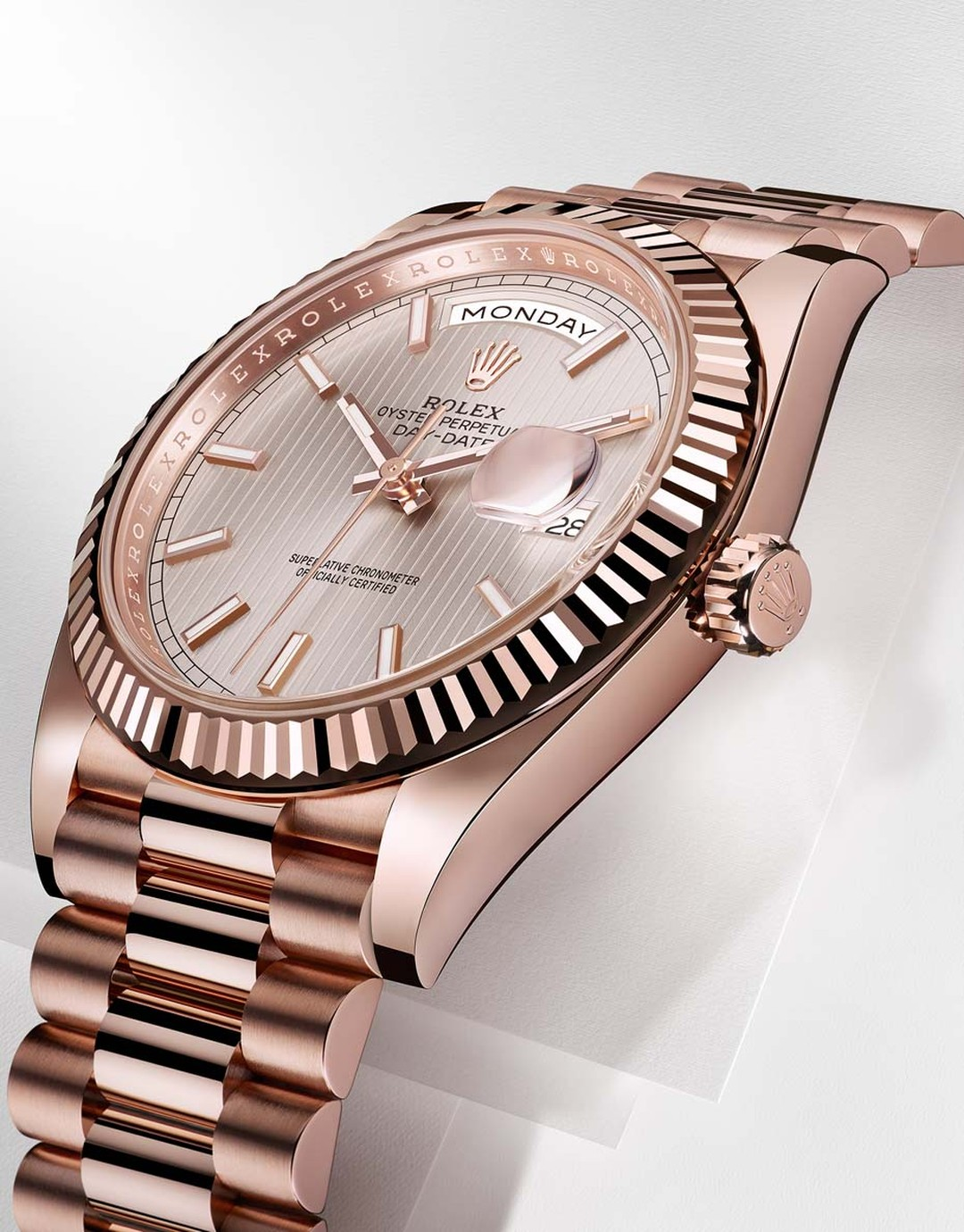 Rolex Oyster Perpetual Day-Date 40mm men's watch with an Everose gold dial with sunburst striped motifs on the dial, a three-piece solid gold link President bracelet and new 3255 Manufacture Rolex calibre.