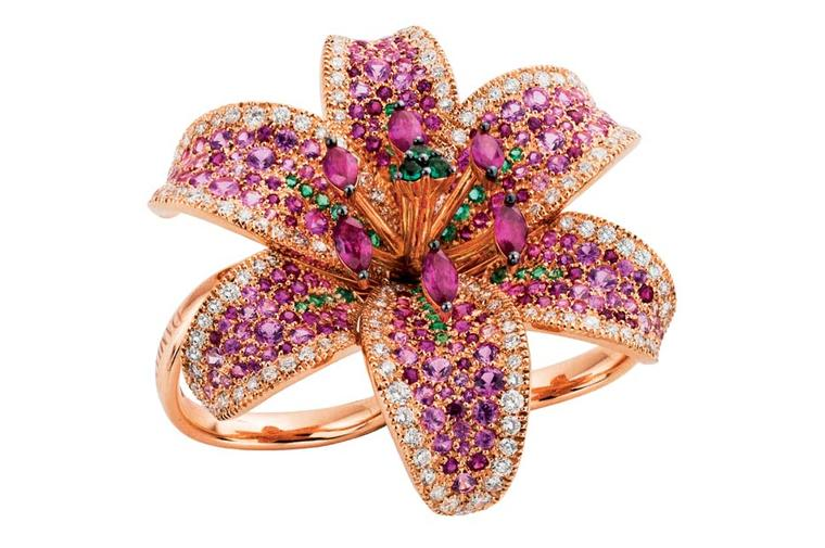 Damiani ring from the new Giglio high jewellery collection, inspired by the white lily, in pink gold with white diamonds, emeralds, sapphires and rubies shading from fuchsia to pale pink.