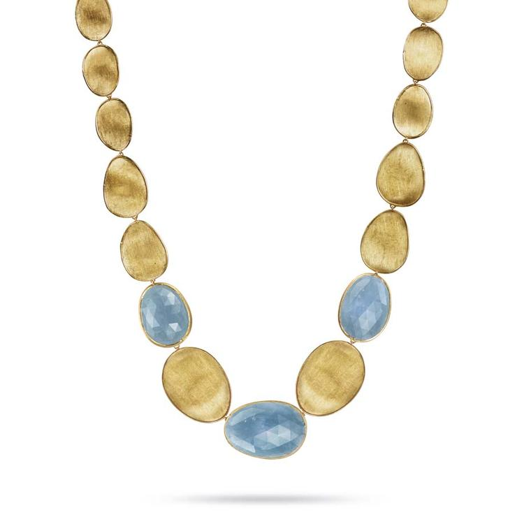 Marco Bicego necklace in yellow gold from the Lunaria high jewellery collection, set with dark aquamarines and engraved with the iconic Mulino finish.