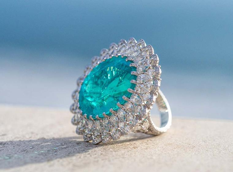 Chopard ring in white gold from the 2015 Haute Joaillerie collection featuring a lacework ribbon of diamonds surrounding by a 41.57ct Paraiba tourmaline.