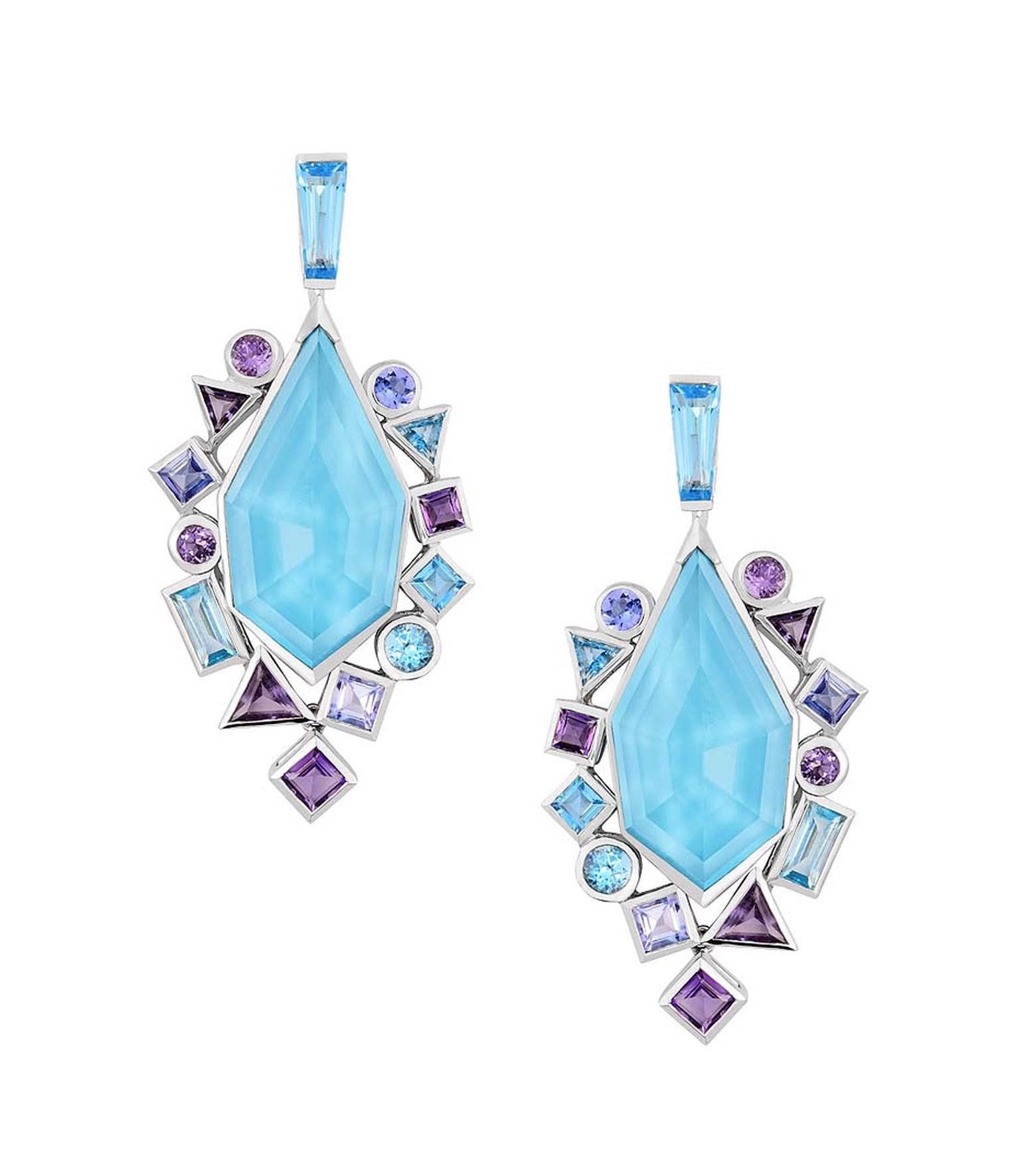 Stephen Webster earrings from the new Gold Struck collection, featuring a central sky-blue facetted crystal with bezel-set blue and mauve stones.