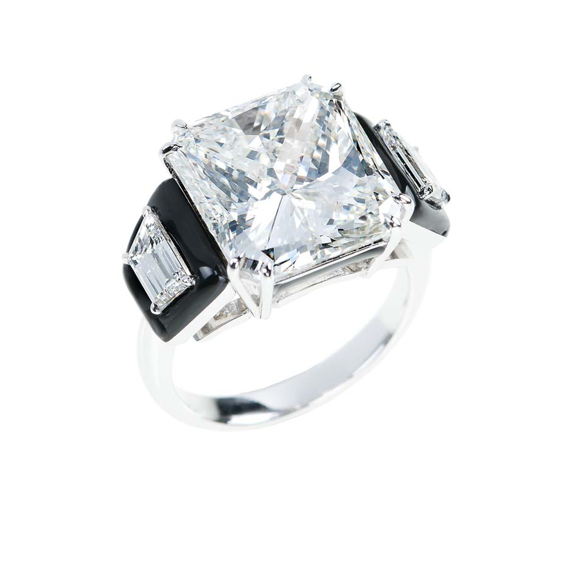 "Nikos Koulis princess-cut diamond engagement ring, with diamonds inset into black enamel, is one of the unique engagement rings from the talented Greek designer's new ""Oui"" bridal collection."