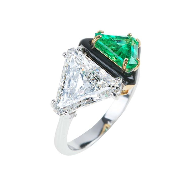 A triangle-cut diamond and emerald, divided by a line of black enamel, give this Nikos Koulis unique engagement ring an Art Deco feel.