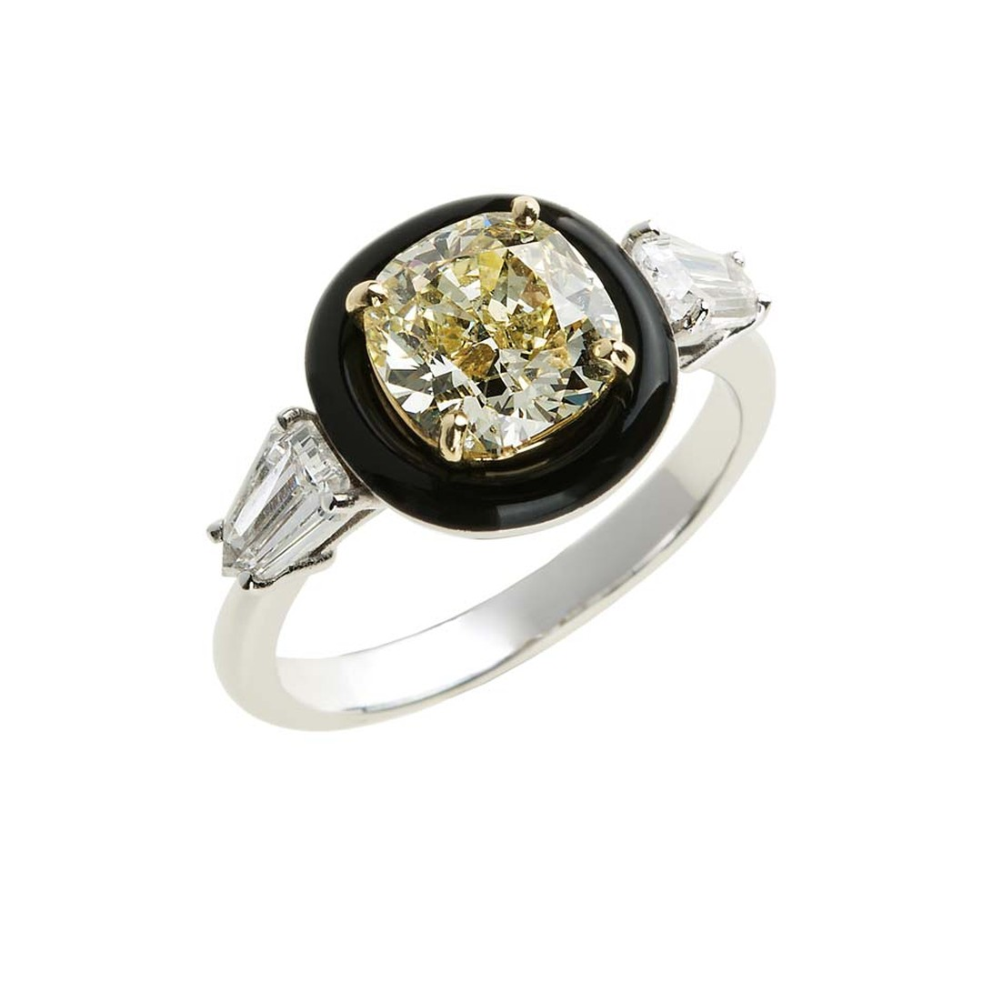 Nikos Koulis fine jewellery diamond engagement ring in white gold, set with a central yellow diamond encircled by a halo black enamel, with baguette diamond shoulders.