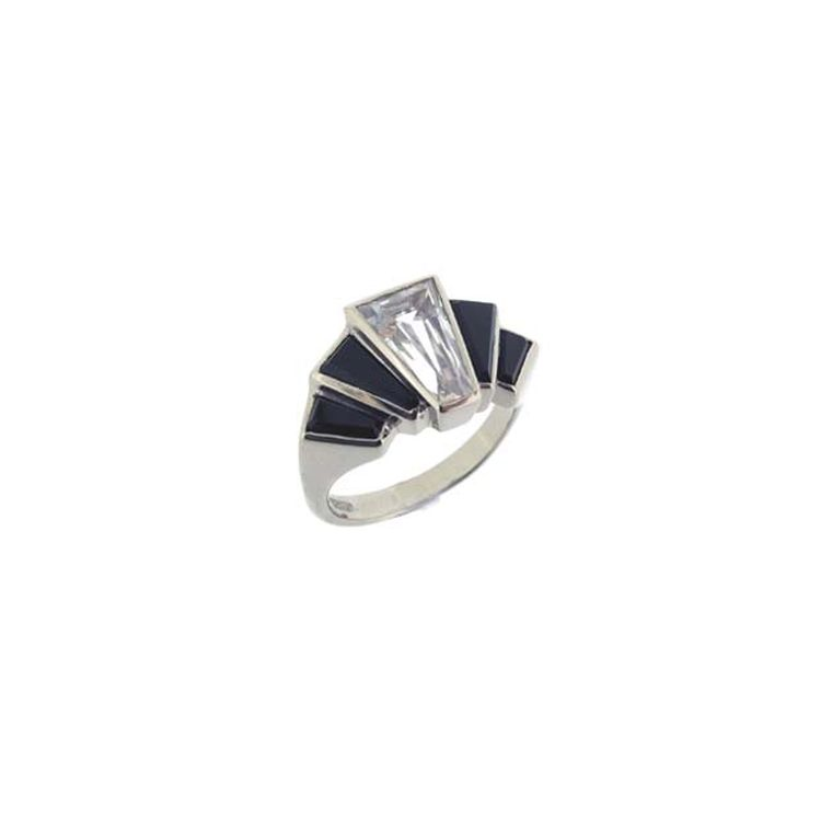 Art Deco-style engagement ring from Baroque Jewellery in white gold set with a tapered baguette-cut white sapphire and black onyx shoulders.