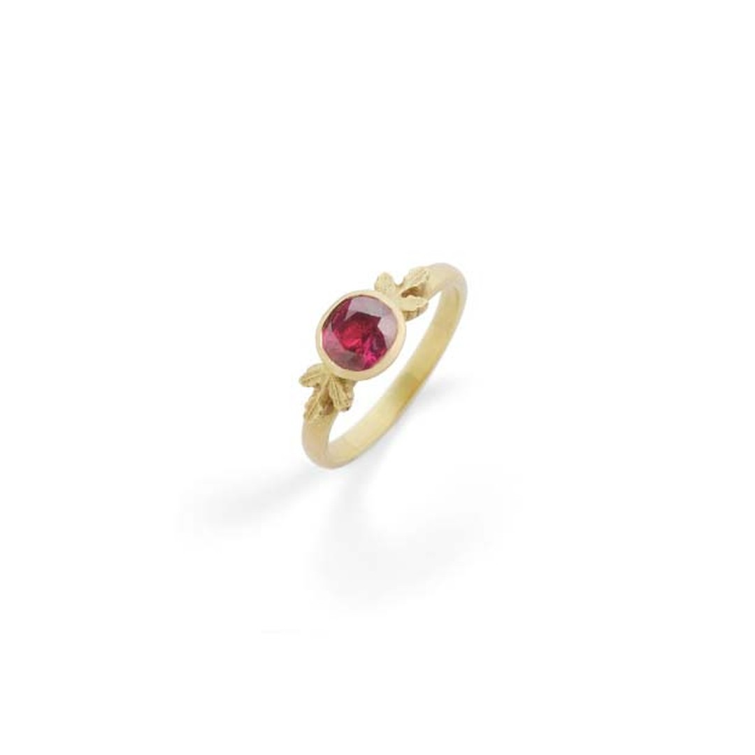 Beth Gilmour ruby unique engagement ring with a yellow gold band featuring the designer's signature oak leaf motif.