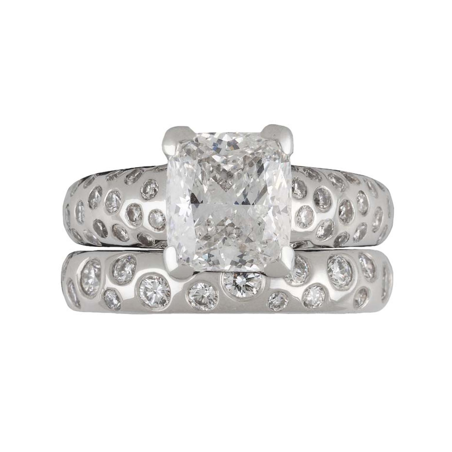 "Dower & Hall ""Fireworks"" engagement ring with a 2.00ct cushion-cut diamond on a platinum band, set with tiny diamonds."