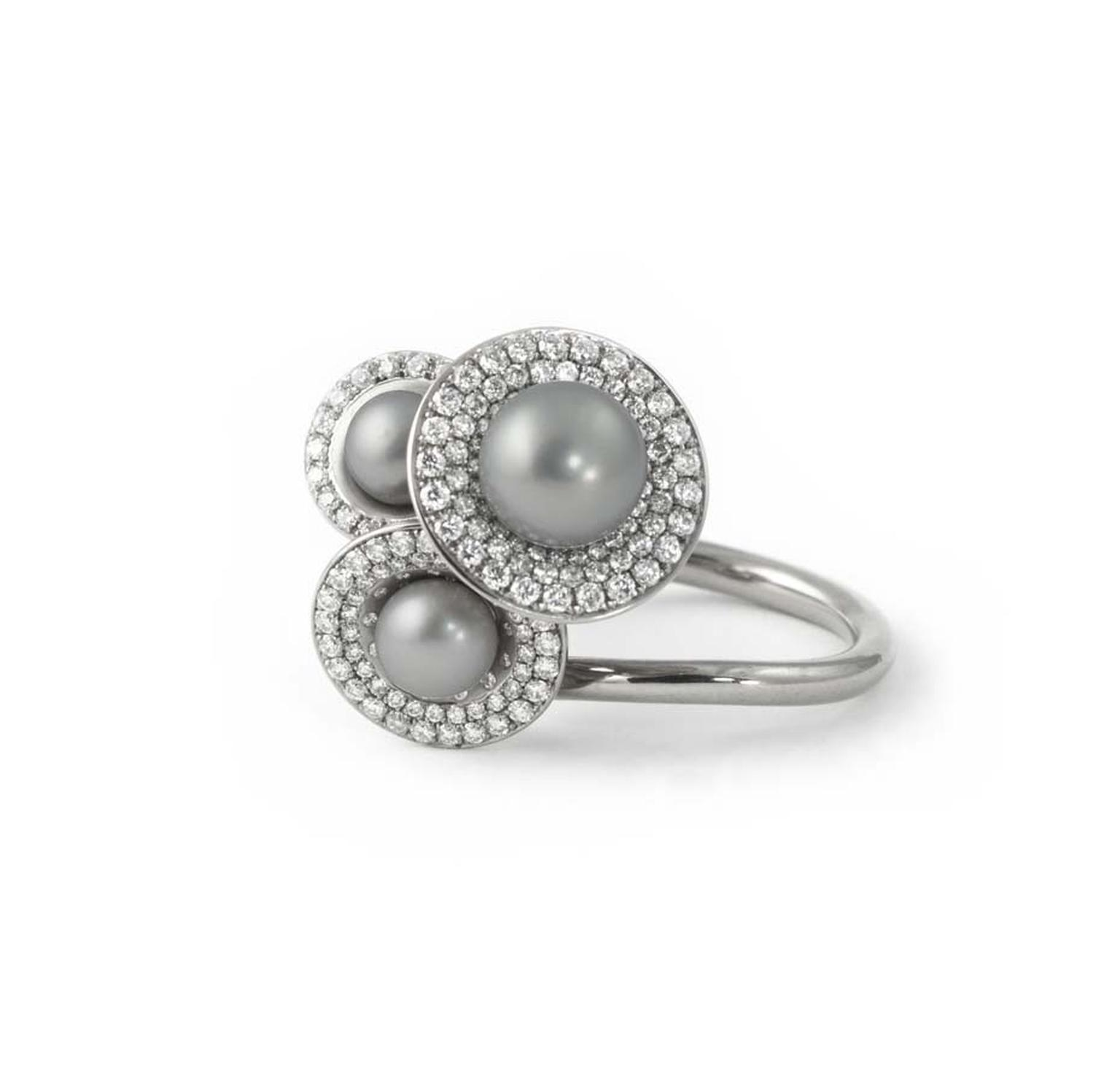 Jessica Poole Jubilee ring in white gold featuring three grey pearls surrounded by micro pavé diamonds is the perfect choice for those seeking unique engagement rings.