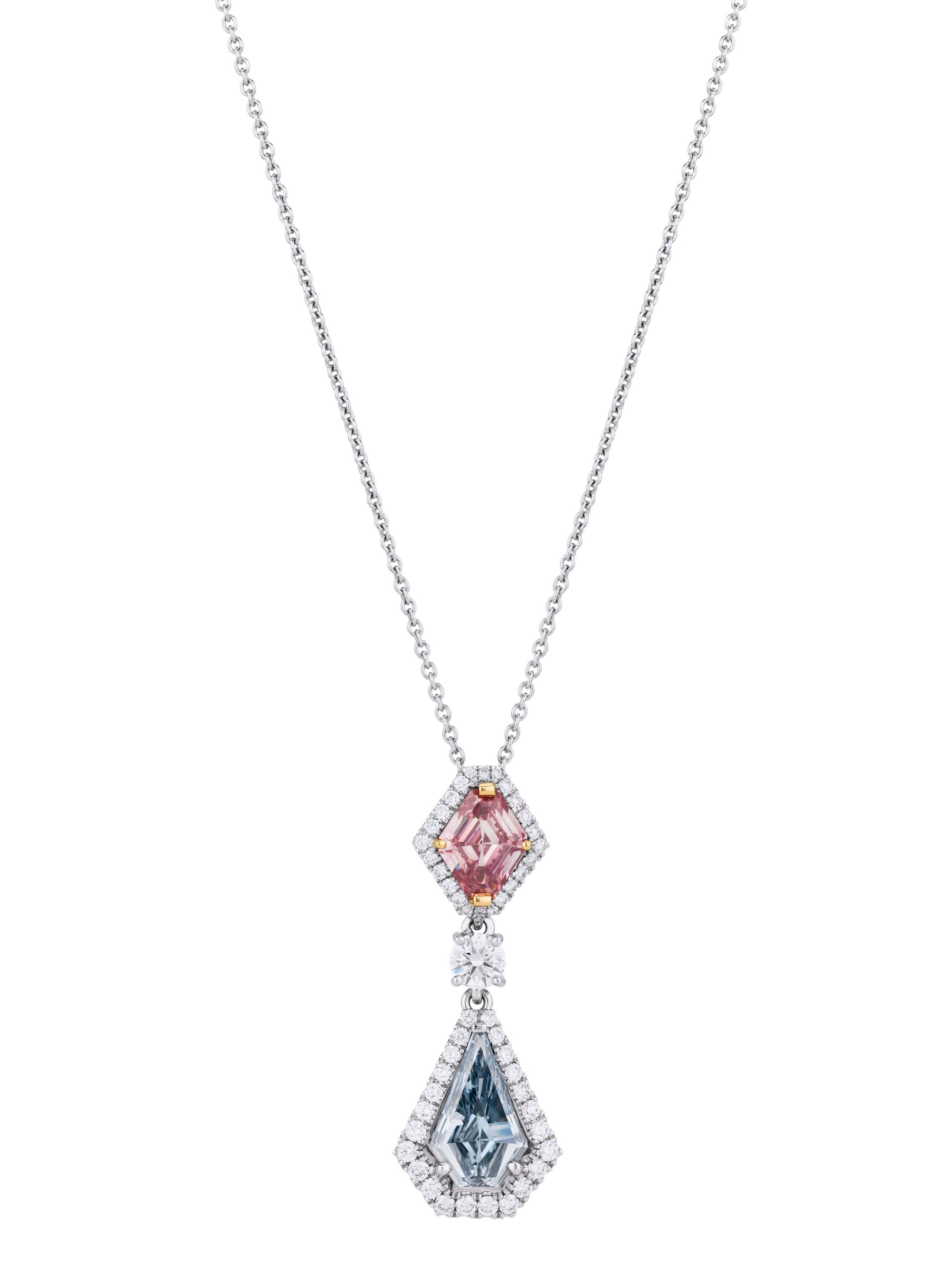 De Beers 1888 Master Diamonds Aura high jewellery pendant, set with a shield-cut Fancy Intense pink diamond, round brilliant diamonds and a shield-cut Fancy Intense blue diamond.