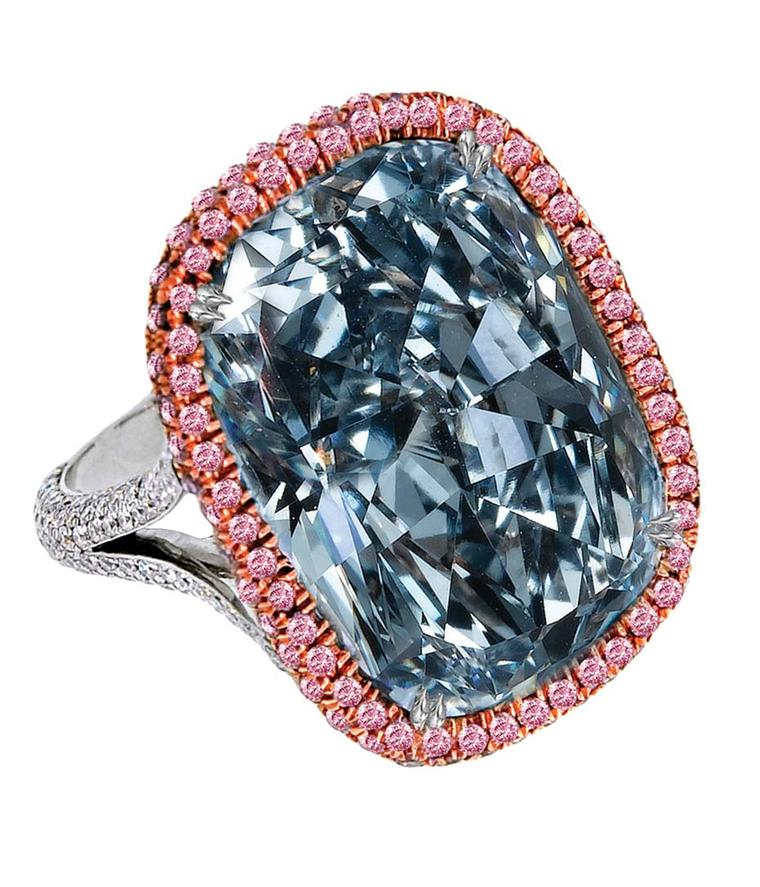 Jacob & Co. blue diamond ring featuring a 30.11ct natural Fancy blue grey cushion-cut diamond, framed by micro pavé-set round brilliant white diamonds and mounted in platinum.