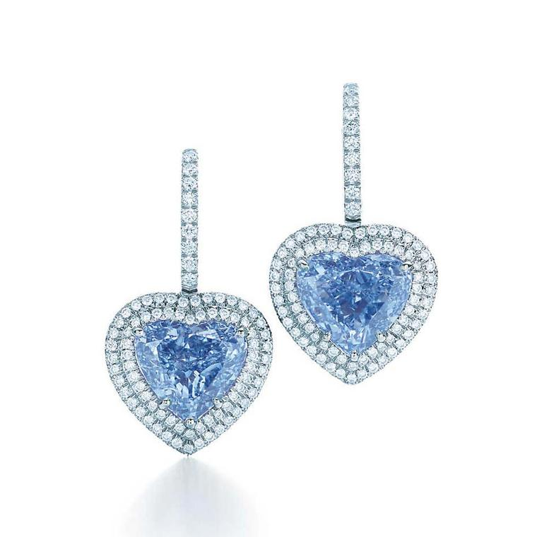 This exceptionally rare pair of heart-shaped Fancy Vivid blue diamond earrings from Tiffany & Co. are set in platinum and surrounded by round brilliant white diamonds.