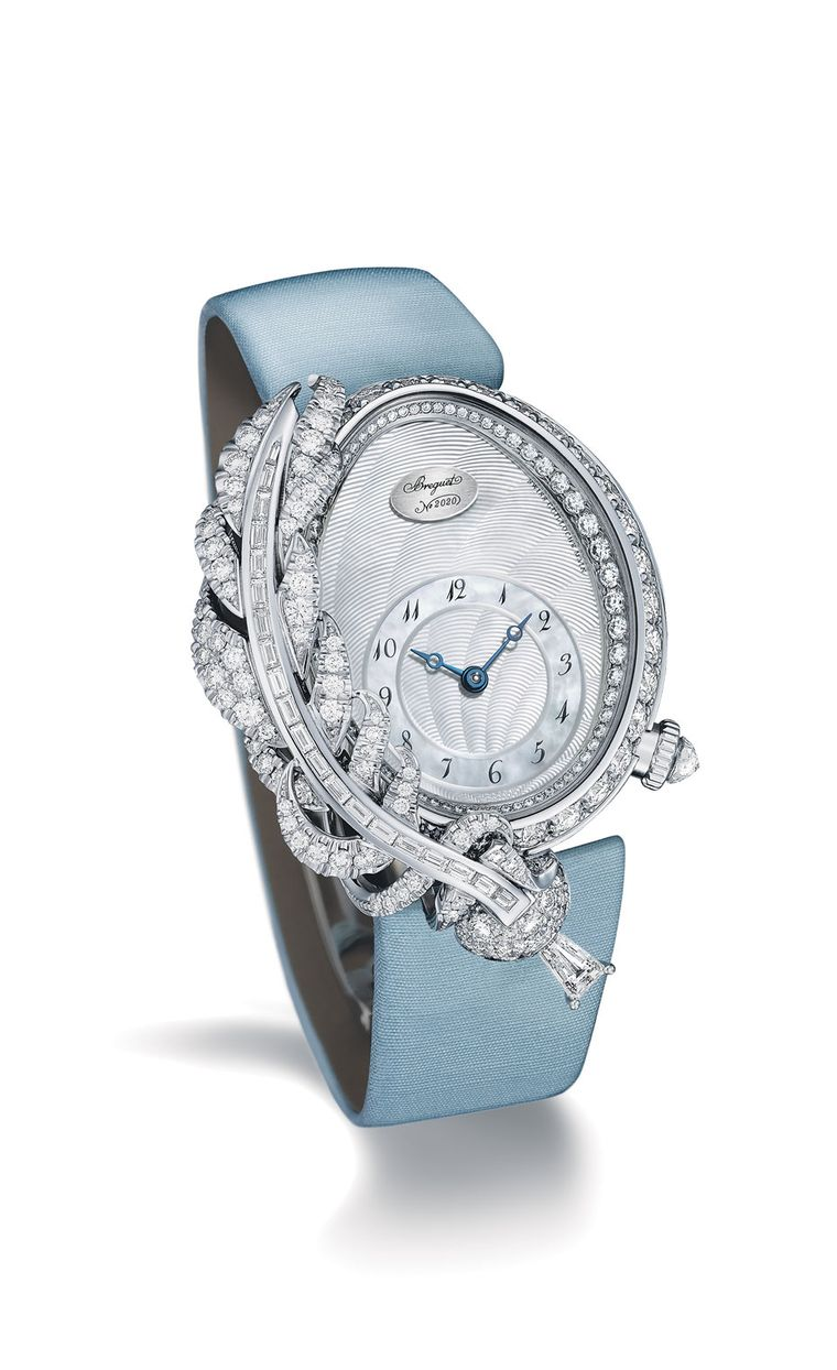 Breguet watches Rêve de Plume high jewellery timepiece draws inspiration from the quill ink pen used by Queen Marie-Antoinette. The white gold model features a feather positioned on the left side of the bezel. More than 4.00 carats of diamonds in differen