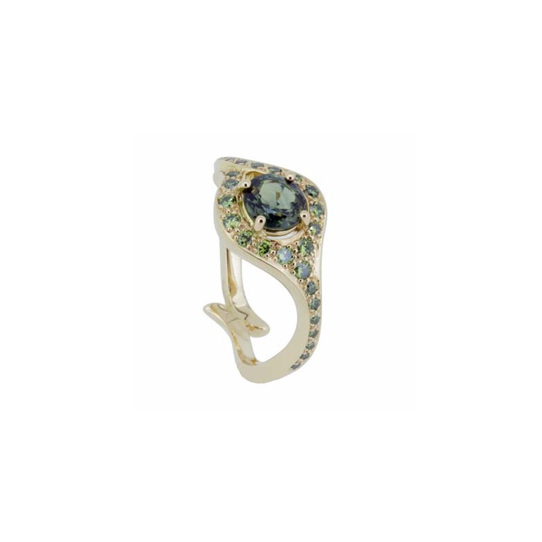 """Atlantis"" engagement ring in yellow gold with a central green sapphire and pavé-set green diamonds, from Baroque Jewellery in Brighton."