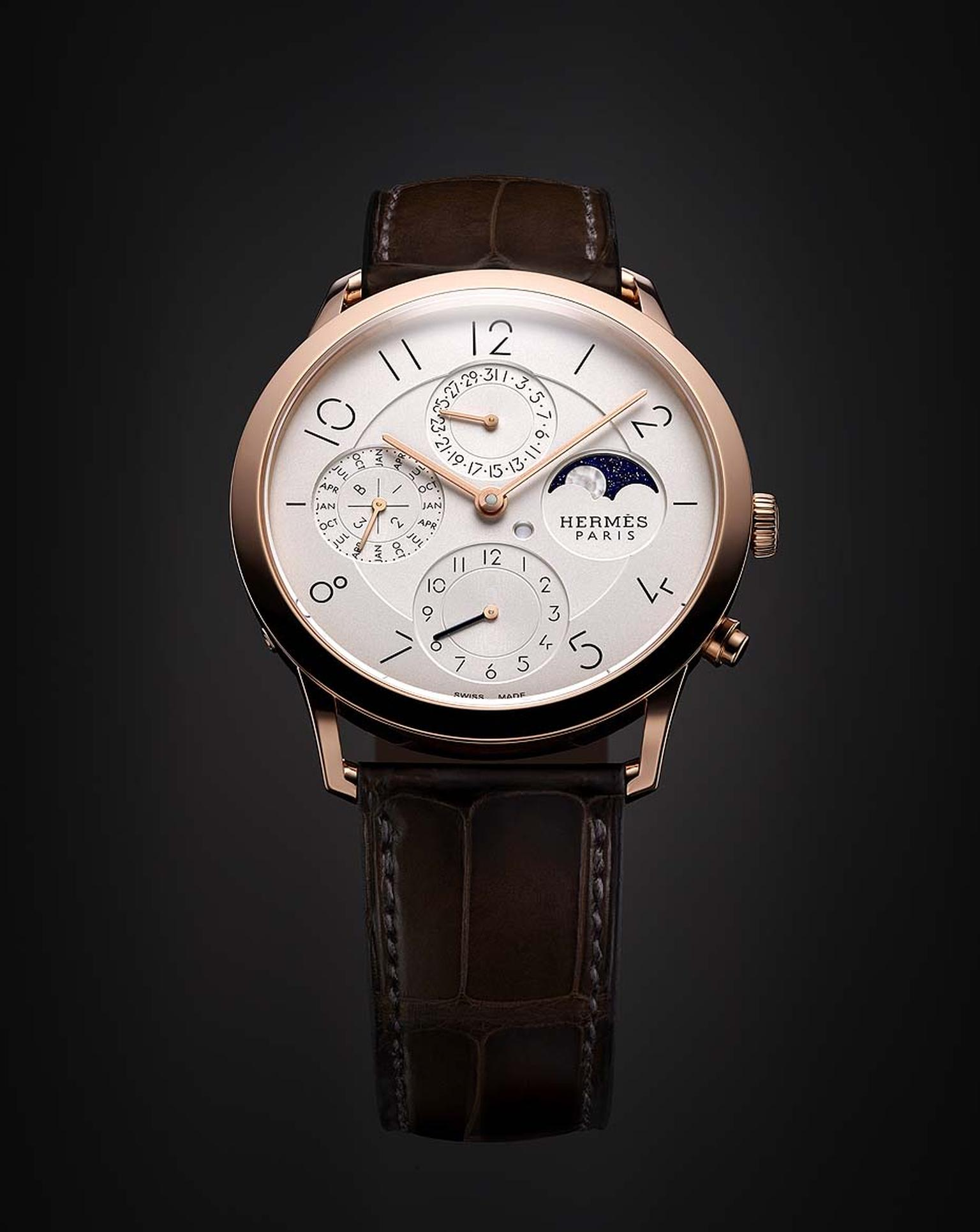 The elegant new Slim d'Hermès collection includes a perpetual calendar men's watch and a Moon phase function in milky mother-of-pearl set against an aventurine glass sky.