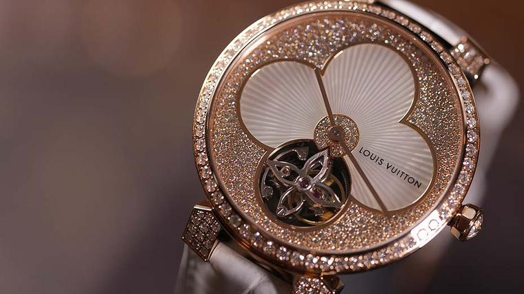 The Tambour Monogram Sun Tourbillon is the season's showstopper, featuring a tourbillon at its heart and an etched mother-of-pearl Monogram flower surrounded by snow-set diamonds.