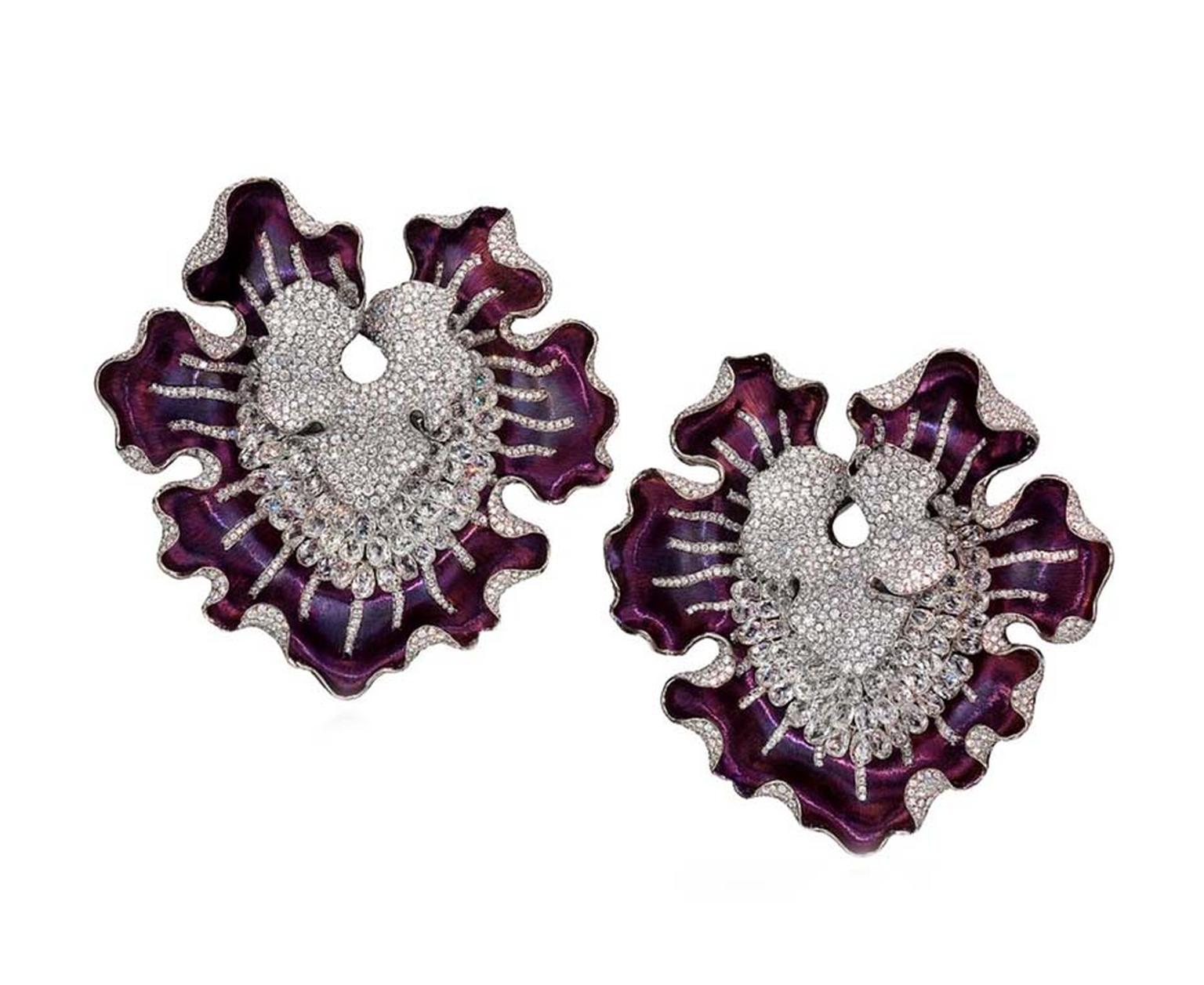 Anna Hu's Magic Orchid high jewellery earrings, worn by Hilary Swank as hair ornaments to the 2011 Oscars, are made of purple titanium metal, set with 2,058 briolette, silver-grey and white diamonds.