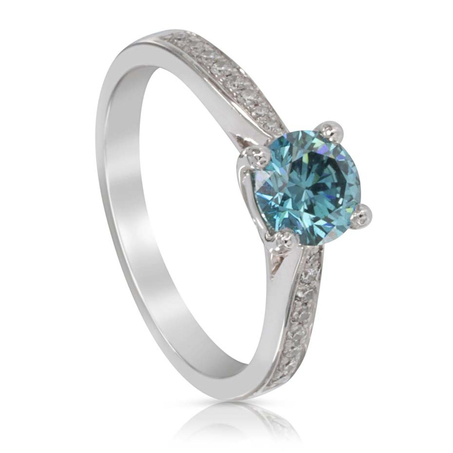 Blue and white diamond ring from Holts London featuring a round brilliant-cut treated blue diamond with diamond shoulders.