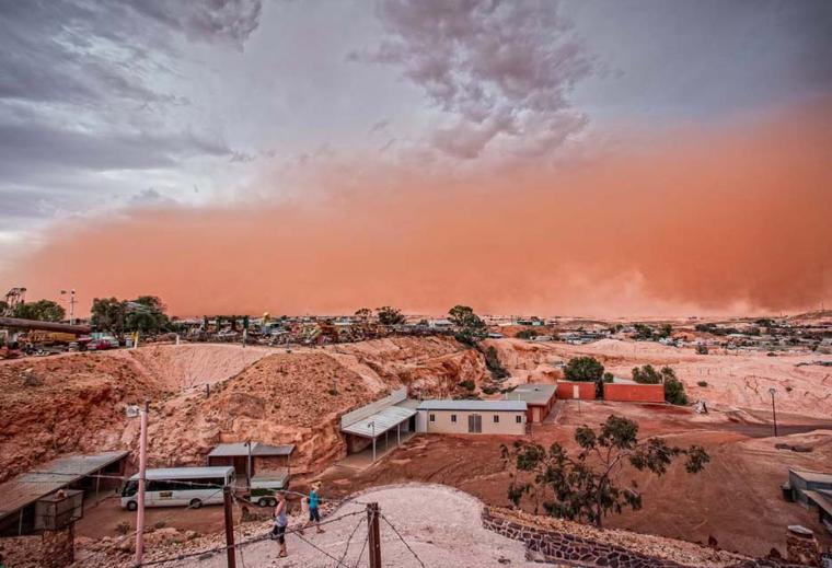 The view of a dust storm from Umoona, Coober Pedy - an underground walk-in mine, tourist accommodation and shop, leased from the indigenous owners of the area. Photo: Courtesy of South Cape Photography / District Council of Coober Pedy.